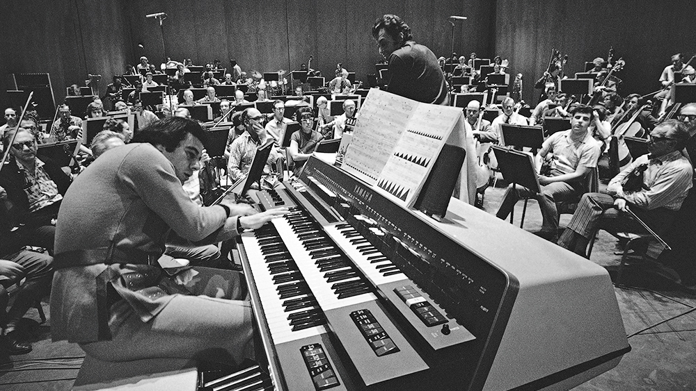 """Mandatory Credit: Photo by George Brich/AP/REX/Shutterstock (6640301a) Lalo Schifrin, Argentine-born composer, rehearses his electronic music-making monster called the Electronic EX-42 with the Los Angeles Philharmonic under Zubin Mehta's direction for the world premiere of his """"Pulsations"""", . The contrivance is part of an electronic musical explosion with widespread implications for producers and musicians Musical Oddities EX42, Los Angeles, USA"""